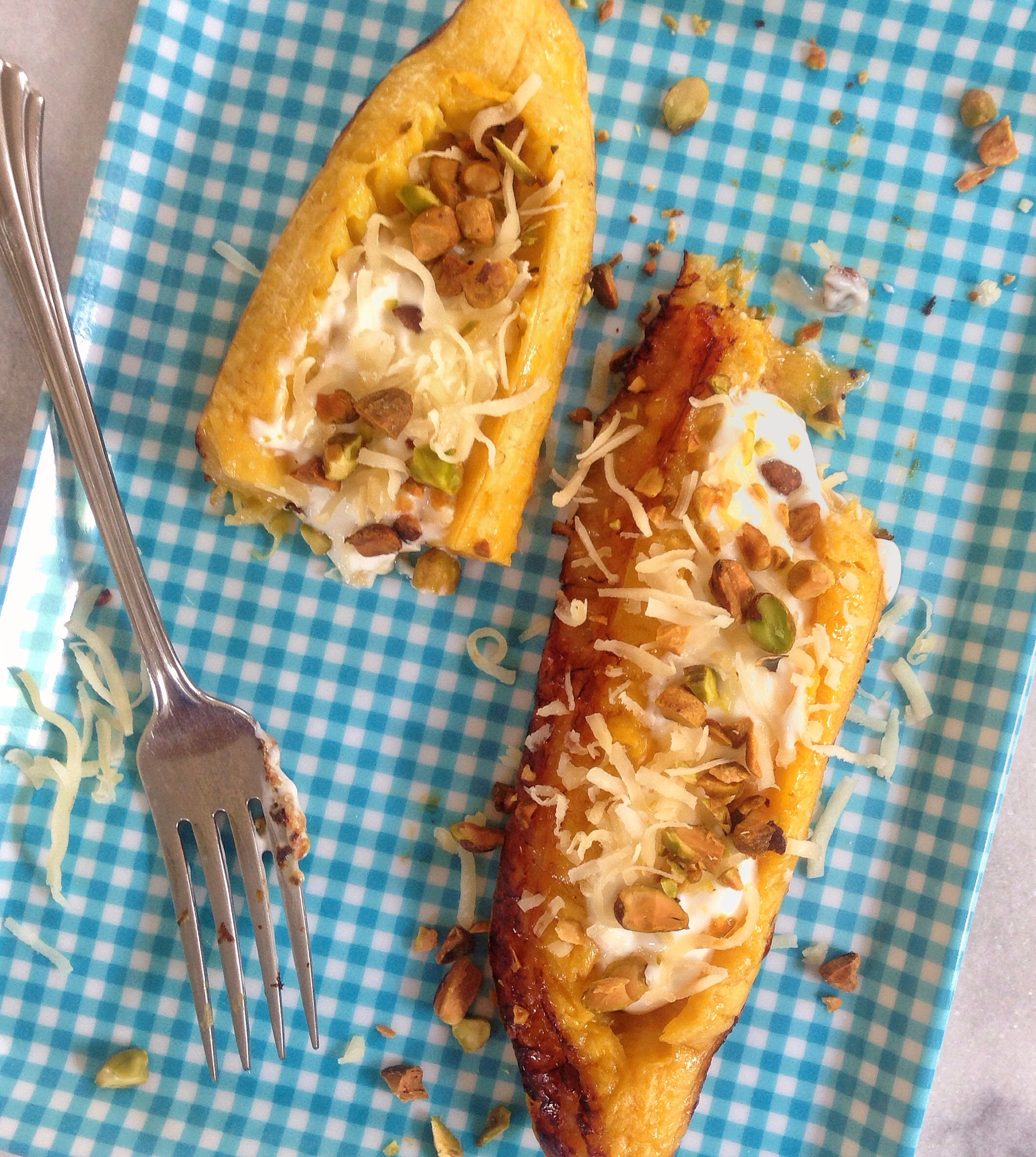 Roasted Plantain Boats filled with Greek Yogurt, Coconut, & Pistachios